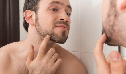 Man Checking Beard Hair Loss