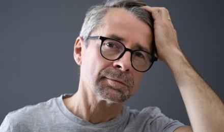 Man Contemplating Hair Transplant Surgery