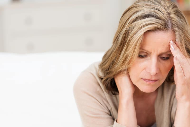 Stressed Woman Worrying About Hair Loss