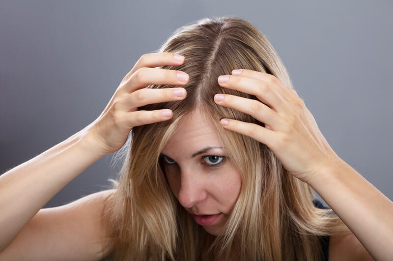 Woman Checking Hair Considering PRP Therapy
